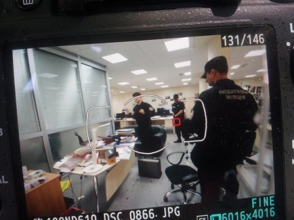 Ukrainian tax police conducting a search inside the sealed office of Vesti