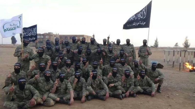 Ahrar (white flag) and Qaeda (black flag) palling around