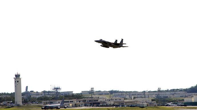 Okinawa: USAF F-15 overflying Kadena air base   Photo: Andre Vltchek