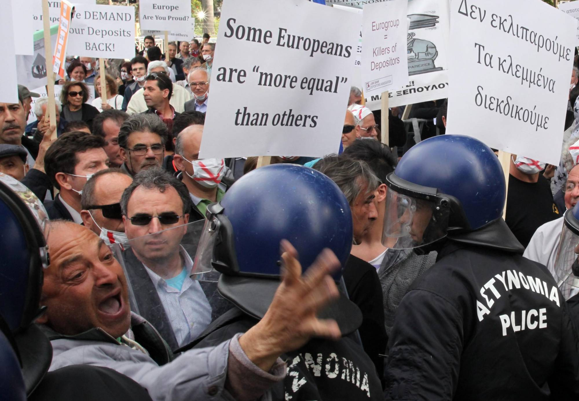 Depositors in the now-defunct Laiki Bank, which closed in Cyprus's 2013 financial crisis, protested  outside Parliament in Nicosia in March | Photo: Katia Christodoulou, uropean Pressphoto Agency