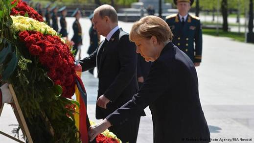 "Merkel's ""compromise after she stayed away from a Russian military parade the day before."""