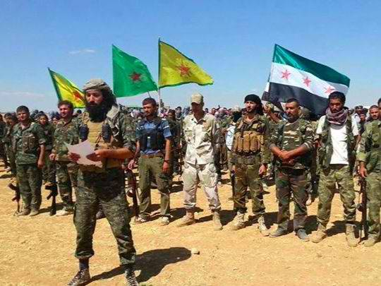 'Army of Revolutionaries' standing by YPG, flying the FSA flag
