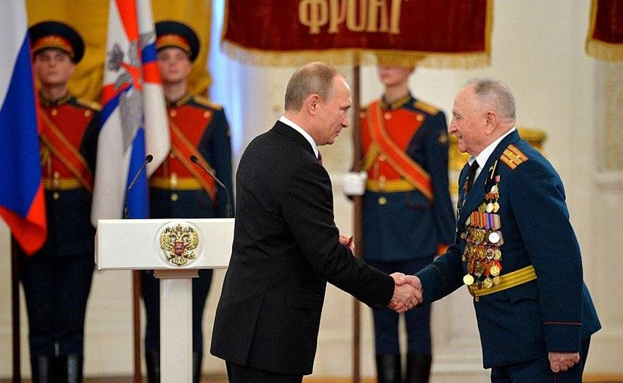 Putin just looks like he belongs as when awarding Great Patriotic War veterans the 70th Anniversary of Victory in the 1941–1945 Great Patriotic War jubilee medal. With Israfil Makeyev, who took part in the Battle of Stalingrad and the liberation