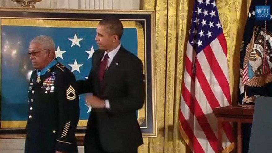 Imagery says a lot - Barack Obama looks so out of place with this hero