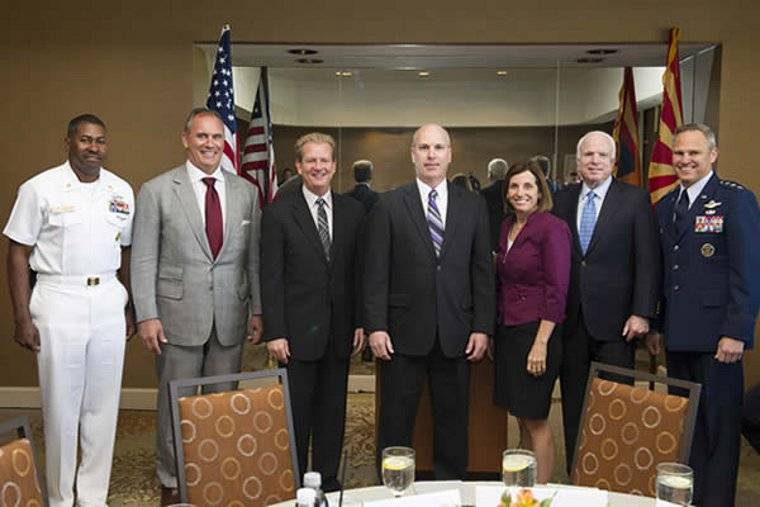 Gary Kochuba, center, was recognized for his work on the Standard Missile-3 program by Dr. Taylor W. Lawrence, president of Raytheon Missile Systems; Riki Ellison, chairman of the Missile Defense Advocacy Alliance; Sen. John McCain; U.S. Rep. Martha McSal