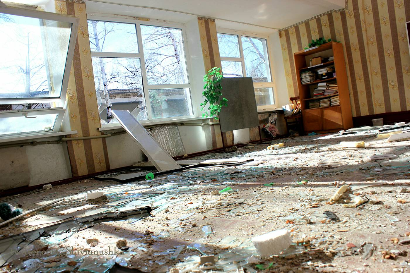 I entered the classroom where Vika and the other first form pupils used to study. Again, the usual scene: pieces of broken glass everywhere, destroyed windows, smashed furniture, holed walls… Books left in a bookcase…