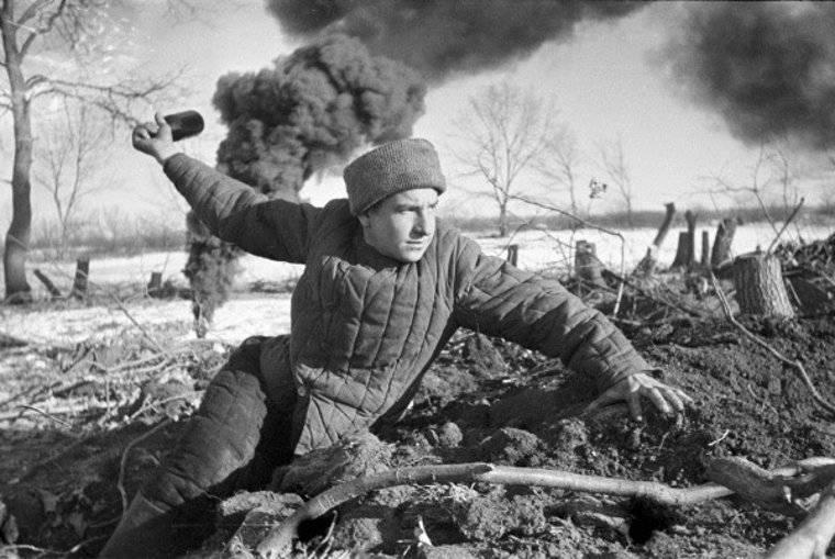 Soviet soldier throwing a grenade near Stalingrad, Russia, 1942 (Georgi Zelma)