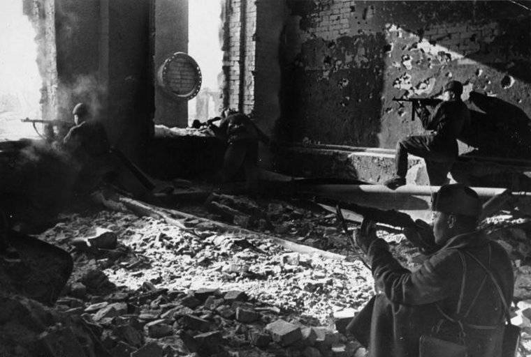 Soviet troops fighting in the ruins of the factory 'Red October', Stalingrad, Russia, Oct 1942; note PPSh-41 submachine guns, and a soldier who had just been shot (Georgi Zelma)
