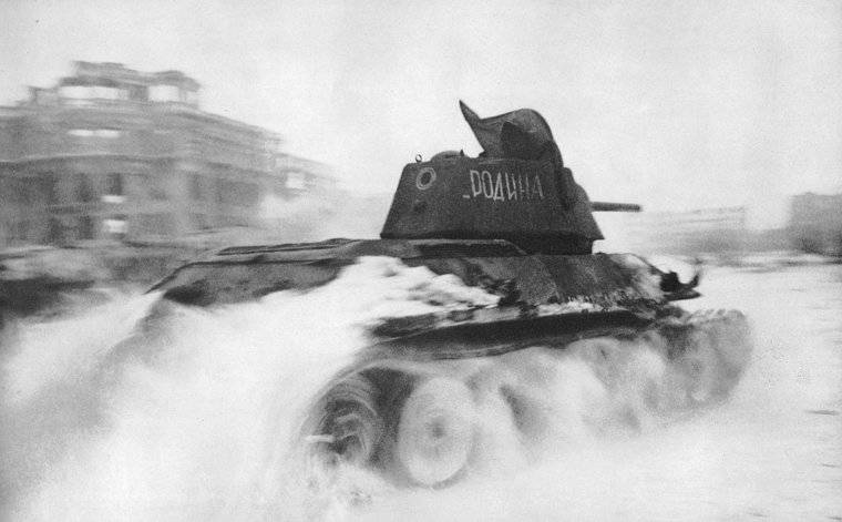 In January of 1943, a Soviet T-34 tank roars through the Square of Fallen Fighters in Stalingrad.(Georgy Zelma)