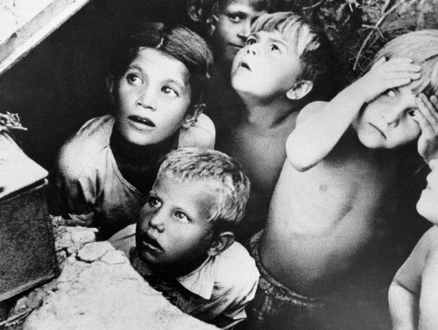 Soviet children during a German air raid in the first days of the war, June 1941, by RIA Novosti archive