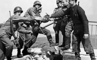 American and Soviet troops symbolically shake hands across the Elbe River on April 25, 1945, in the final days of World War II in Europe