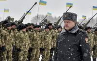 Ukrainian president Petro Poroshenko walks along a formation of soldiers during his visit to the Zhitomir Region