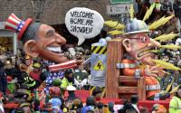 Carnival float depicting US president Barack Obama, left, putting whistleblower Edward Snowden on an electric chair during the traditional carnival parade in Duesseldorf, western Germany.