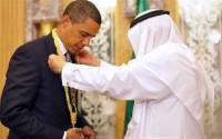 Obama, being awarded the prestigious Most Improved Head-Chopper necklace