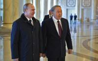 Kazakh President Nursultan Nazarbayev (R) meets with his Russian counterpart Vladimir Putin in Astana, March 20, 2015