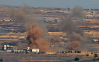 Israel strikes Syrian army in second flare-up in two days. Pictured: Smoke billows from the Syrian side of the border, Golan Heights, Israel, June 25 / AFP
