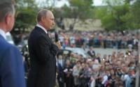 Russian President Vladimir Putin addresses a crowd on May 9, 2014, celebrating the 69th anniversary of victory over Nazi Germany and the 70th anniversary of the liberation of the Crimean port city of Sevastopol from the Nazis
