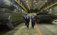 "Putin inspecting ""unprincipled"" Russian tanks"