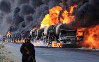 ISIL oil trucks burning on their way to Turkey after an attack by Russian air force