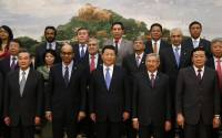 China's President Xi Jinping poses for photos with guests at the Asian Infrastructure Investment Bank launch ceremony at the Great Hall of the People in Beijing  Read more: http://www.businessinsider.com/r-south-korea-sees-gains-for-its-infrastructure-fir