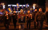 Oleg Tyagnibok, leader of Ukrainian far right Svoboda party in 2009 with supporters and a picture of Stepan Bandera