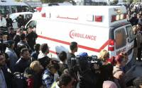 People surround an ambulance carrying the bodies of the victims of an attack by gunmen on Tunisia's national museum in Tunis, March 18, 2015.