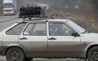 A boy looks out the window as he rides in a car on the road near Artemivsk, eastern Ukraine
