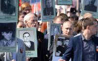 Vladimir Putin joined the Immortal Regiment march with a photograph of his father, who fought in the war.