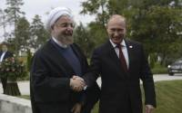 Russia's President Vladimir Putin (R) shakes hands with his Iranian counterpart Hassan Rouhani at the welcoming ceremony during a summit of Caspian Sea regional leaders in the southern city of Astrakhan, September 29, 2014.
