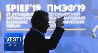1000 Strong Chinese Delegation Swarms Putin's Davos (Russian TV News)