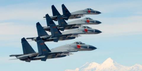 Pilots from China's PLA Air Force take part in flight training over southwest China