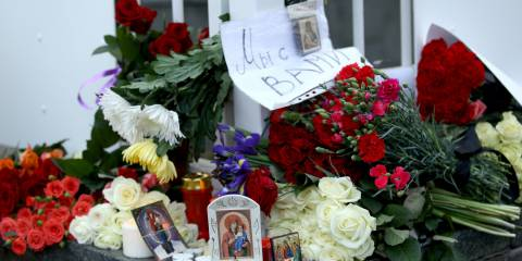 Muscovites are laying flowers and Orthodox icons at the French Embassy in Moscow