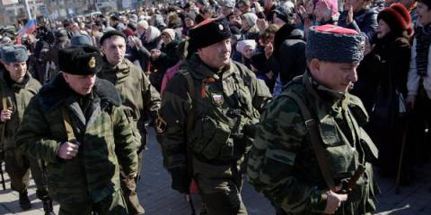 Pro-Russian rebels were greeted in Donetsk on Monday during a rally to celebrate their recent victory over the Ukrainian Army in Debaltseve
