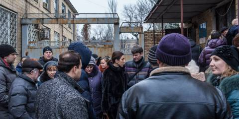 Waiting in Velikaya Novoselka, Ukraine, to apply for permits to cross the front line | Photo: Brendan Hoffman for The New York Times