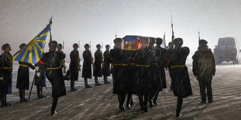 A guard of honour greets the coffin of Russian Lt Col Oleg Peshkov, pilot of the Russian plane shot down by Turkish forces