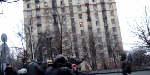 YouTube screenshot of shots being fired on police and protesters from Hotel Ukraina on Feb 20, 2014
