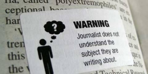Надпись на плакате: Внимание! Журналист не понимает, чего несет!