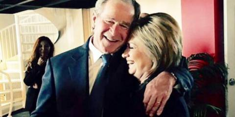 Hillary Clinton and George Bush embrace at Nancy Reagan's funeral
