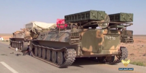 SAA advancing with 9K35 Strela-10 in tow