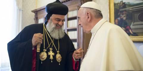 Ignatius Aphrem II, Syriac Orthodox Patriarch of Antioch, speaks with Pope Francis
