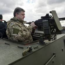 Ukrainian President Petro Poroshenko examines a British-made Saxon armored personnel carrier with a Ukrainian weapon system while visiting a military base outside Kiev on April 4, 2015   Photo: Genya Savilov, AFP