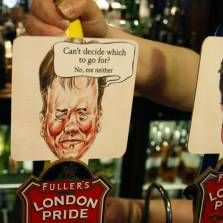 Beer pumps in a Westminster pub are coloured and decorated with the British main political party politicians   Photo: AP