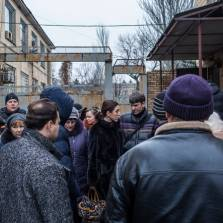 Waiting in Velikaya Novoselka, Ukraine, to apply for permits to cross the front line   Photo: Brendan Hoffman for The New York Times