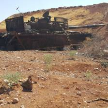 Remains of dead ISIS fighters lie beside the wreckage of their suicide tank after they tried to crash through the wall of the Koyeress airbase