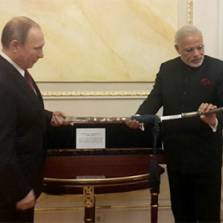 Symbolic gifts from Putin to Modi: a manuscript by great pacifist Mahatma Gandhi and a Bengali sword