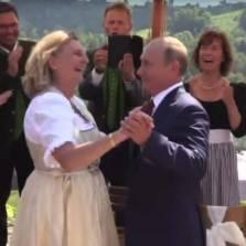 Putin's Wedding Trip Seals Marriage of Convenience With Merkel