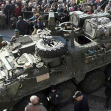 "People gather around an U.S. Army 2nd Cavalry Regiment ""Stryker"" armored fighting vehicle in Bialystok, Poland, which is a part of the U.S. military ""Dragoon Ride"" operation. March 24, 2015 