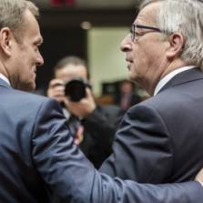 European Council President Donald Tusk, left, speaks with European Commission President Jean-Claude Juncker during a round table meeting at an EU summit in Brussels on Friday, March 20, 2015   Photo: AP
