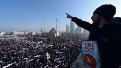 Chechen Muslims gather in downtown regional capital of Grozny to take part in a protest rally against the French satirical weekly Charlie Hebdo, Jan. 19, 2015.