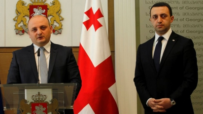 Mindia Janelidze the newly appointed Georgian Defense Minister, left, speaks during a news conference in Tbilisi, Georgia, Nov. 5, 2014. (AP Photo/Shakh Aivazov)